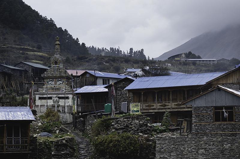 The village of Lho under grey skies at dusk