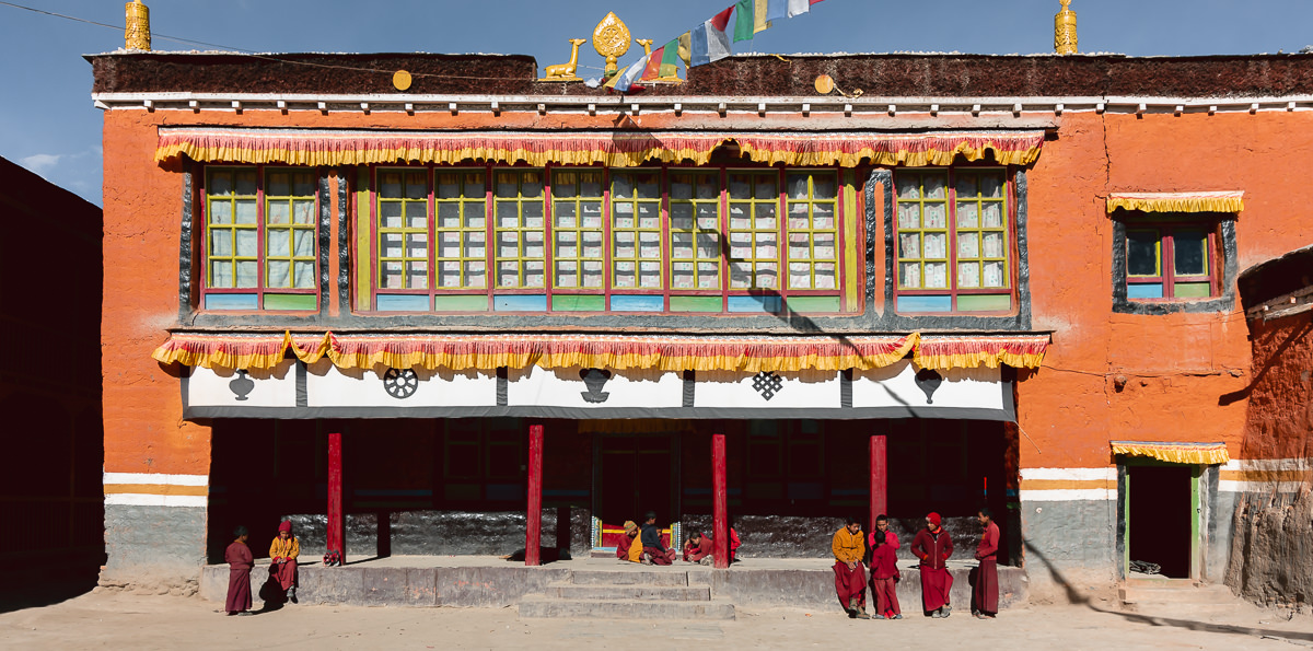 Young monks sitting in the courtyard of Dragkar Thegchen-Ling (Chode) Gompa in Lo Manthang