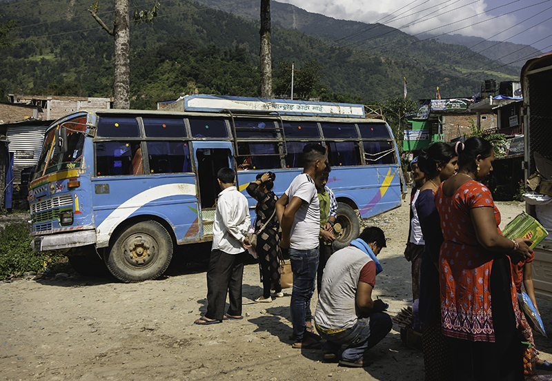 Local bus and people waiting between Arughat and Soti Khola at the start of the Manaslu Circuit