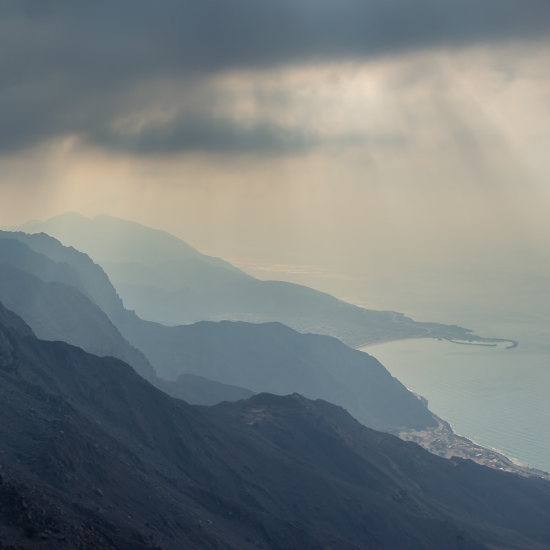 Looking down to the coast from Harf Plateau under stormy atmospheric skies
