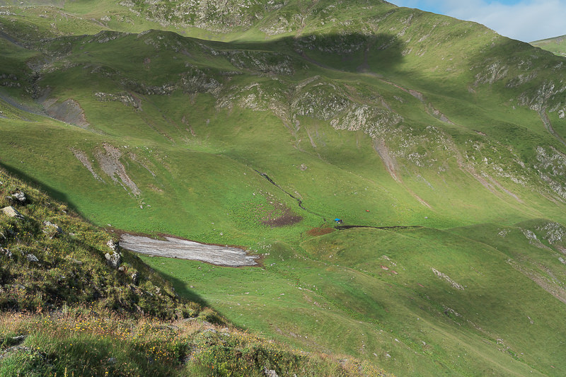 A morning view back down to Masara shepherd camp from the trail on Day 4 of the Tusheti to Pankisi Valley trek