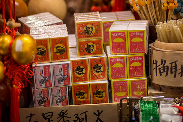 Day Trip From Taipei: Old styled matchboxes for sale on Jiufen Old Street, Taiwan