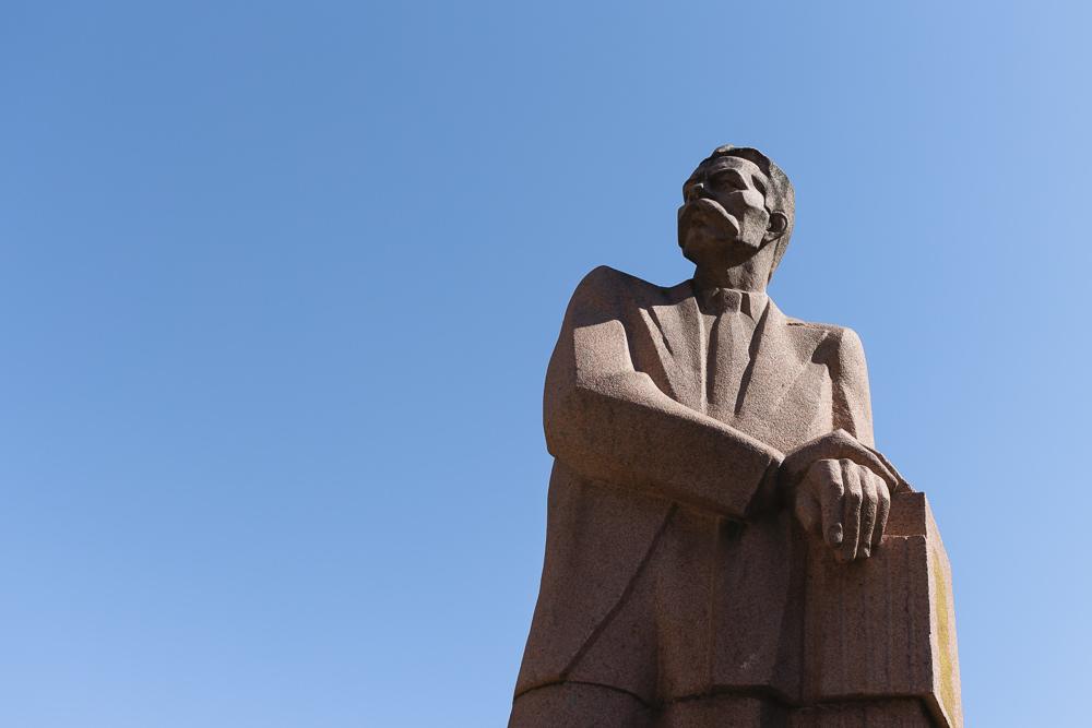 A Soviet-era statue of Maxim Gorky against a blue sky, Bishkek