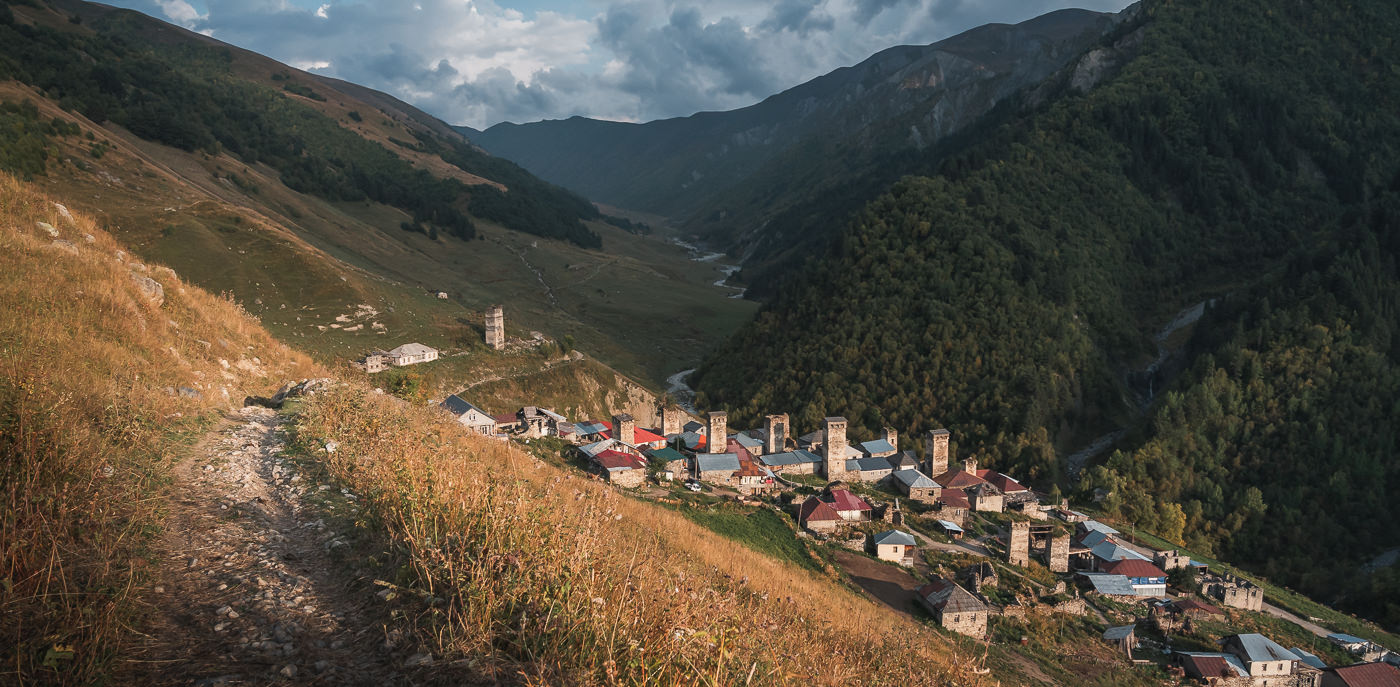 The village of Adishi glowing in the late afternoon sun on the Mestia to Ushguli section of the Transcaucasian Trail in Svaneti, Georgia
