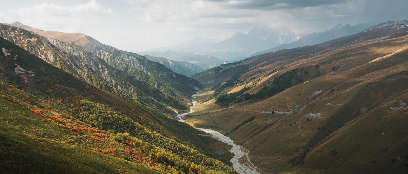 Sunlight and shadow on the Adishchala valley, seen from Chkhunderi Pass on the Mestia to Ushguli trek