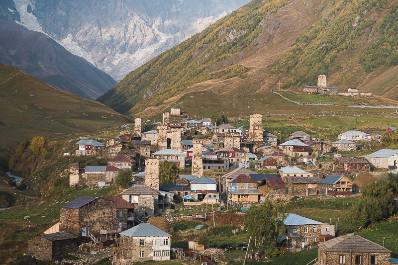 The stone towers and houses of Zhibiani and Chvibiani - upper Ushguli - glowing in the afternoon sun, a fine sight to greet you at the end of the Mestia to Ushguli trek