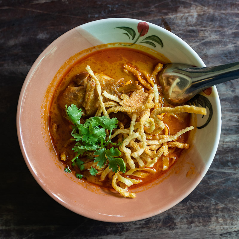 A bowl of delicious Khao Soi, one of the most famous Lanna Cuisine dishes