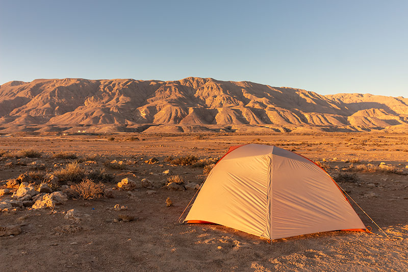 Morning glow on the tent and Eastern Hajar Mountains, Oman