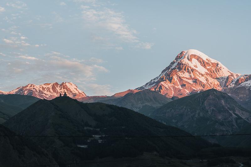 Sunrise view of Mt. Kazbek and Gergeti Holy Trinity Church from Kazbegi (Stepantsminda) in Georgia