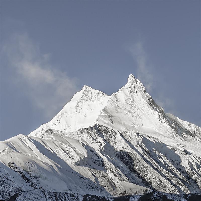 Mount Manaslu at first light, seen from Samagaun on the Manaslu Circuit in Nepal