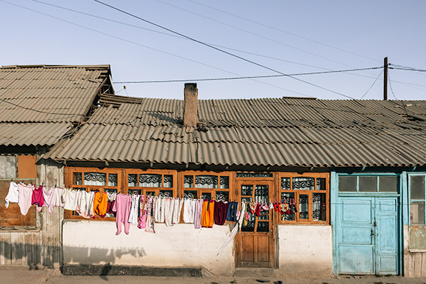 Colourful laundry hanging in front of a traditional house in Murghab