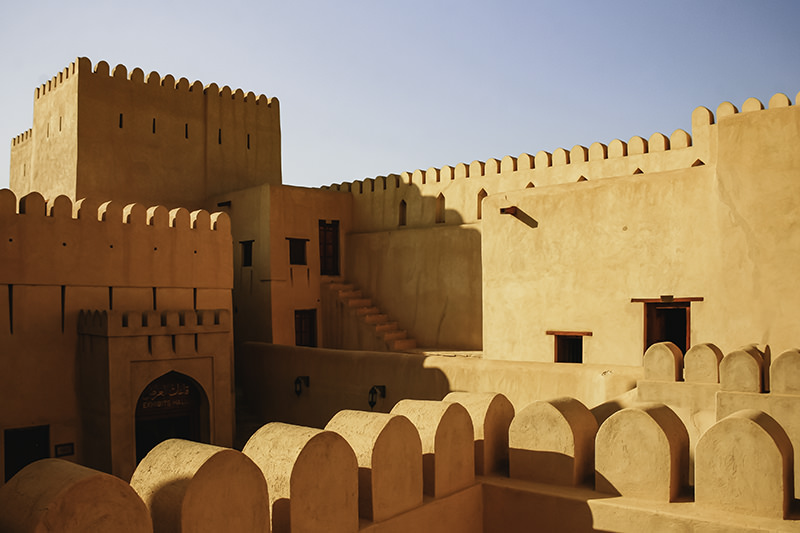 Inside the sandy coloured inner fort at Nizwa on Day 6 of a 10 day Oman Itinerary