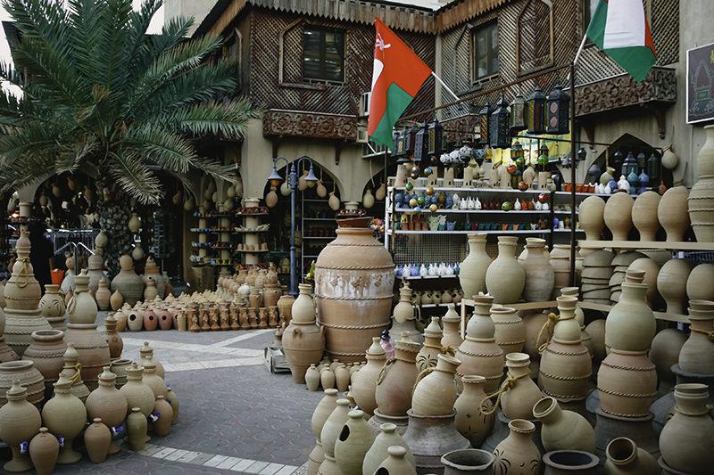 Stacked shelves of pottery outside the entrance to Nizwa Souk in Nizwa, Oman