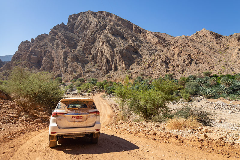 Our Toyota Fortuner is caked thick with mud as we tackle the final wadi on our 26 day Oman camping road trip