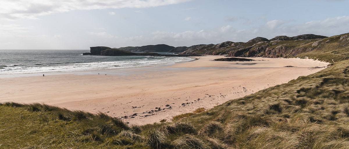 The sun shining on the wide expanse of Oldshoremore Beach, a short side trip away from the main North Coast 500 route in Scotland