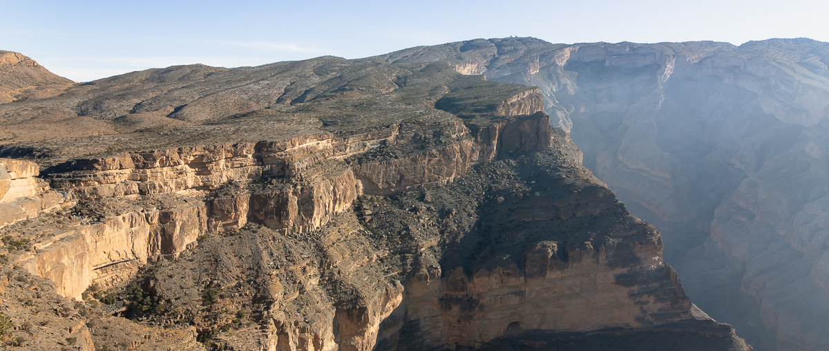 A view down into the dramatic Oman Grand Canyon and across to the country's highest mountain, Jebel Shams