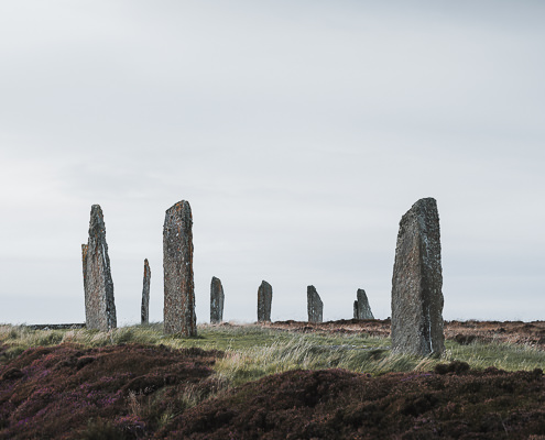 Standing stones set in a large circle, known as the Ring of Brodgar, one of Orkney's most iconic sites and Scotland's largest stone circle