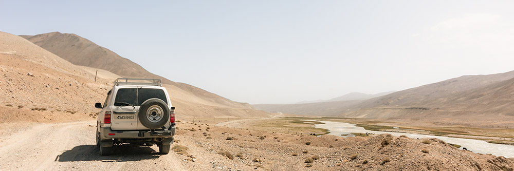 A Toyota Lancruiser is parked on the dirt road to Zorkul in Tajikistan