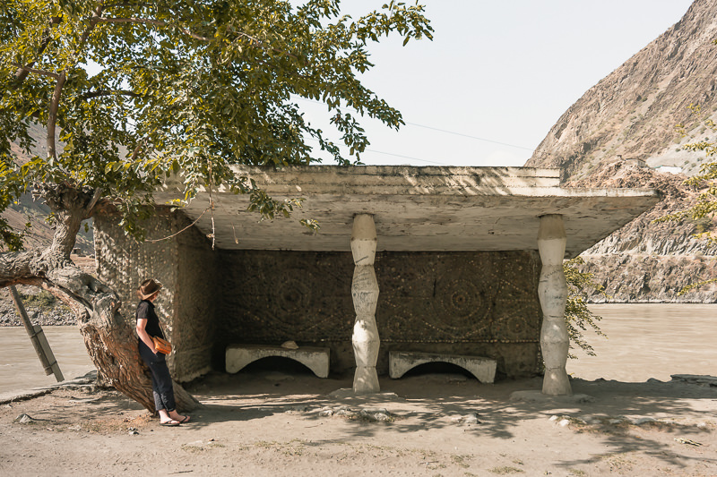 A Pamir Highway Soviet bus stop decorated with swirling geometric designs, on the banks of the Panj River between Kalai Khum and Rushan in Tajikistan