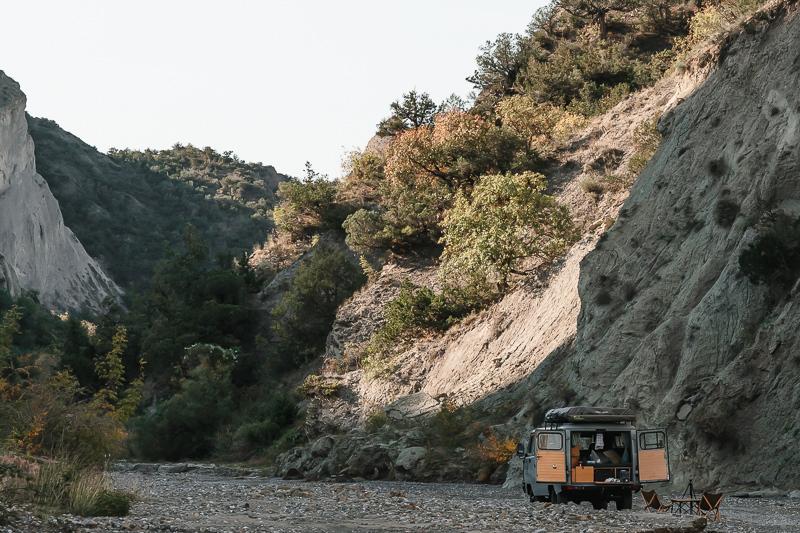A UAZ Buhanka camper van parked beneath the cliffs in Pantishara Canyon, Vashlovani National Park