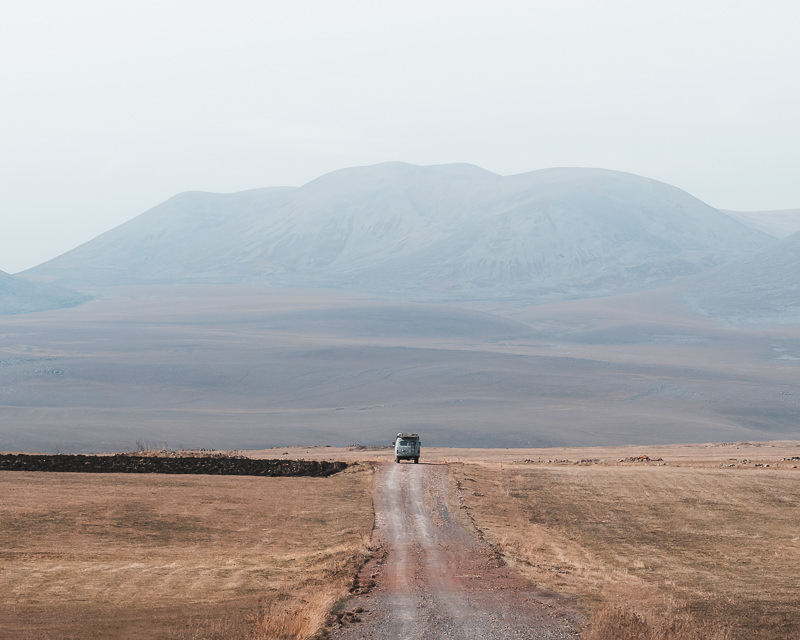 A lone vehicle on the dirt track that leads to the western side of Paravani Lake on the Javakheti Plateau in Georgia