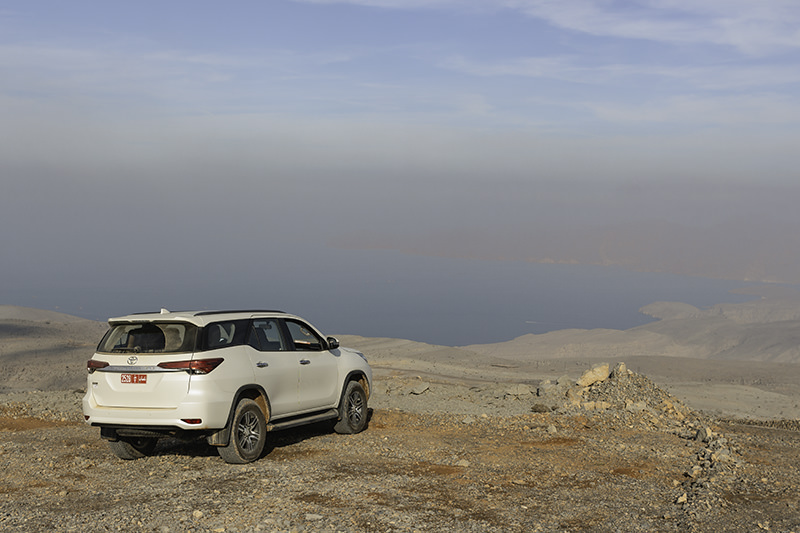 Parked up on the Harf Plateau in Musandam, looking out to a hazy view of the Strait of Hormuz