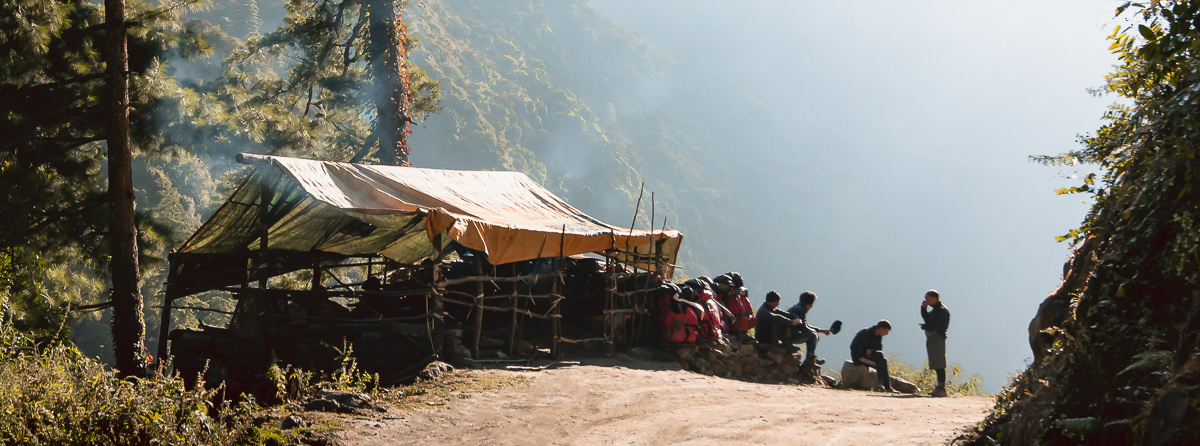 Porters resting at the roadside on the Annapurna Circuit