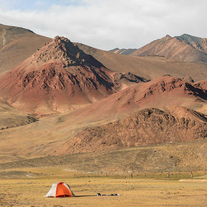 A tent pitched at a wild camp spot in the Pshart Valley