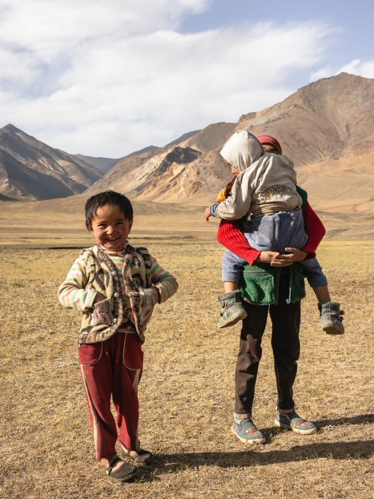 Friendly kids from nomad families smile at the camera in the Pshart Valley near Murghab in Tajikistan.