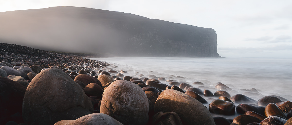 The sea encroaches on the rocky shore of Rackwick Bay on Hoy, one of the Orkney Islands