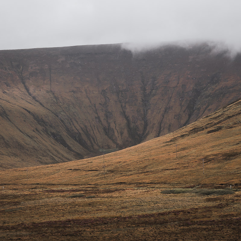 Mist hangs over the top of Rackwick Glen on Hoy while sunlight tries to shine through