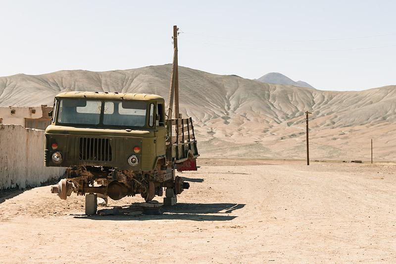 An old Soviet truck sitting on bricks in Rangkul Village, Tajikistan