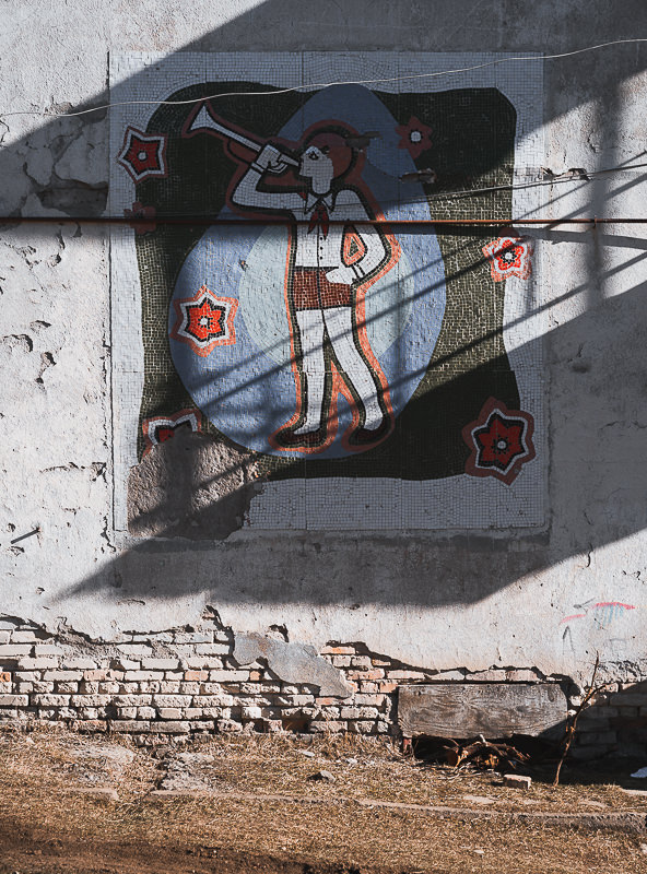 A mosaic of a girl blowing a bugle on the wall of the former Red Carnation Pioneers' Camp in Kojori, Georgia