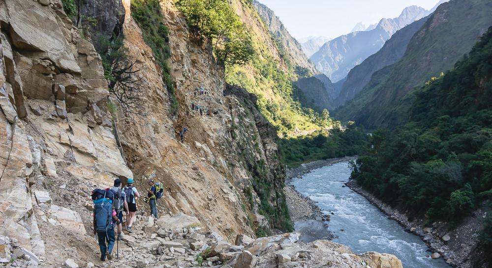 Trekkers follow a rocky path high above the Budhi Gandaki on the Manaslu Circuit Trek