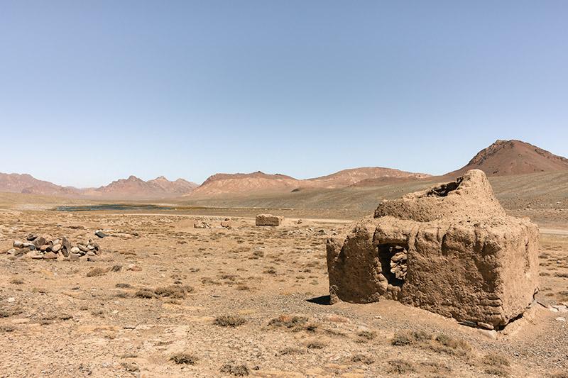 Mud brick ruins an Saka kurgan burial grounds on a Pamir Highway Road Trip