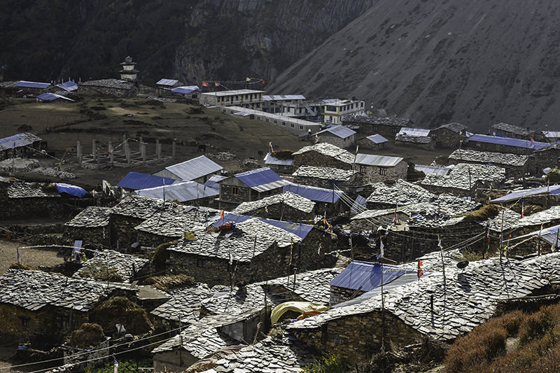 Sun lighting up the tiled roofs of the stone houses in Samdo on the Manaslu Circuit
