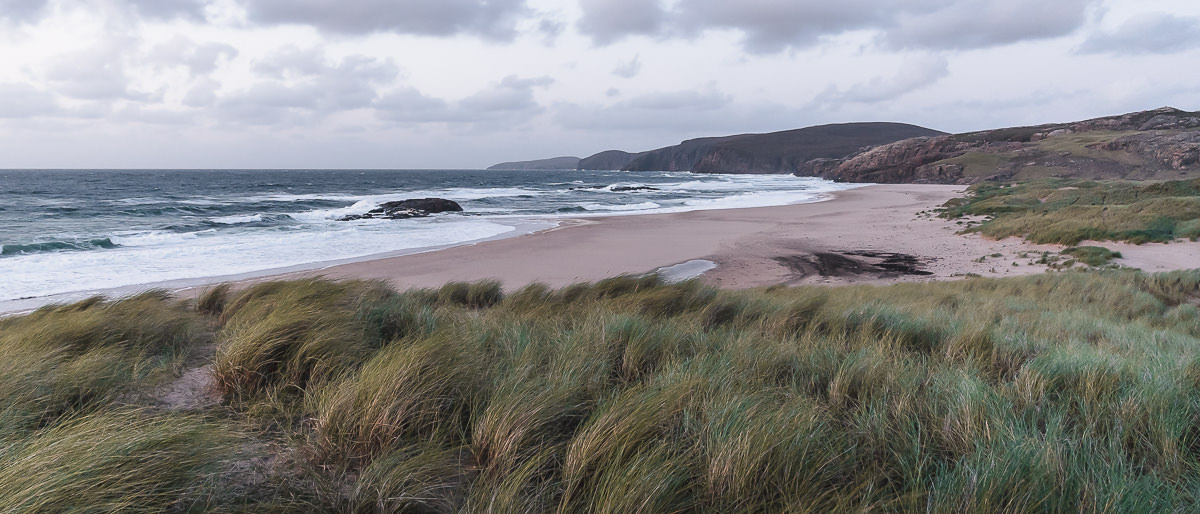 Sandwood Bay on a cool and overcast morning,the coastline extending into the distance towards Cape Wrath