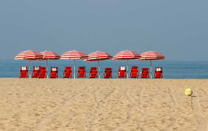 A photographic journey: Parasols and beach chairs lined up along the shore, Santa Monica Beach, LA