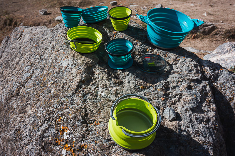 Sea To Summit X-Set Cookware, seen here drying on a rock, is always part of our backpacking camping gear