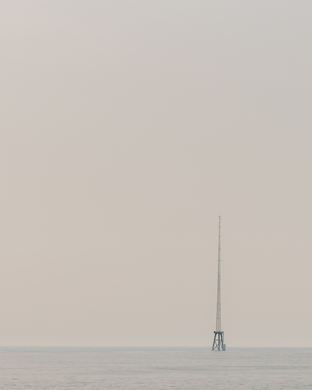 A communications aerial rising from the sea like a giant needle in the channel between Gapa-do and Jeju-do