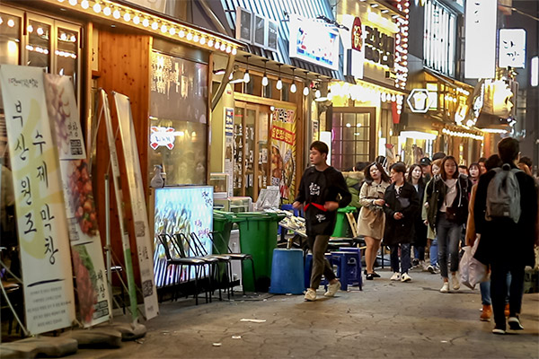 Busan City Guide: Busy street at night in Seomyeon area