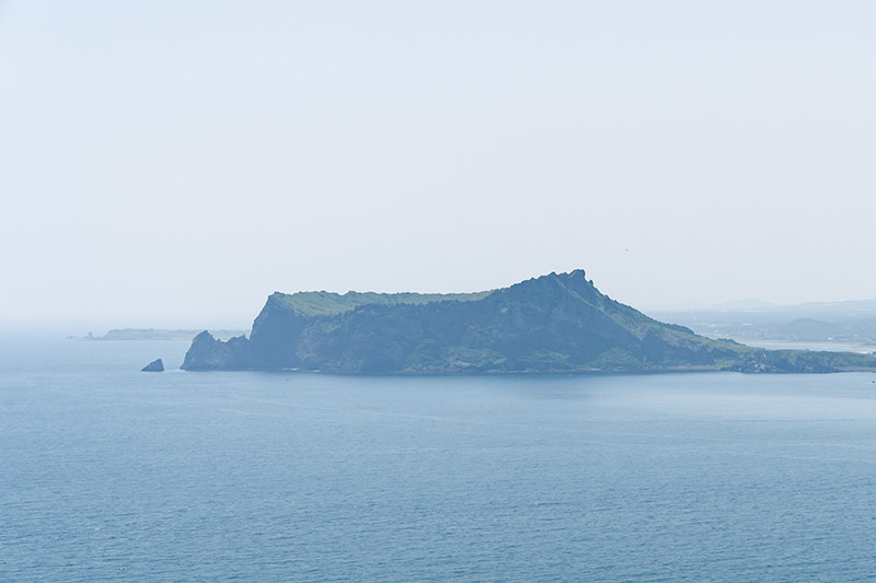 A view of Seongsan Ilchulbong from Udo while walking on the Jeju Olle Trail