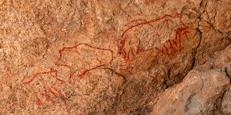 Red Neolithic cave paintings of animals in Shakthy Cave