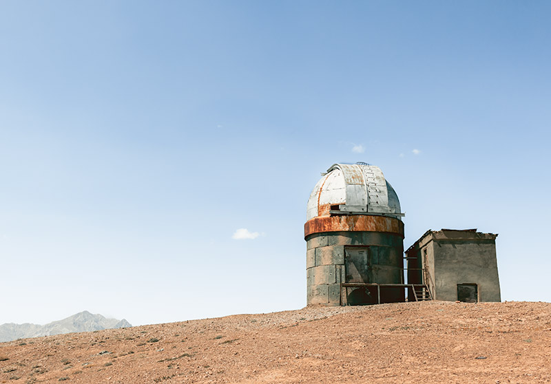 The abanonded Soviet era Shorbulak Observatory, a rusting building with a commanding view over the Pamirs and mountains of Xinjiang Province of China