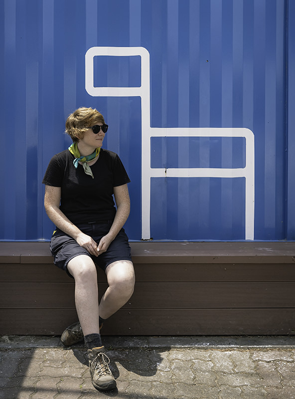 A person sits outside the Jeju Olle Information Centre in Hamo