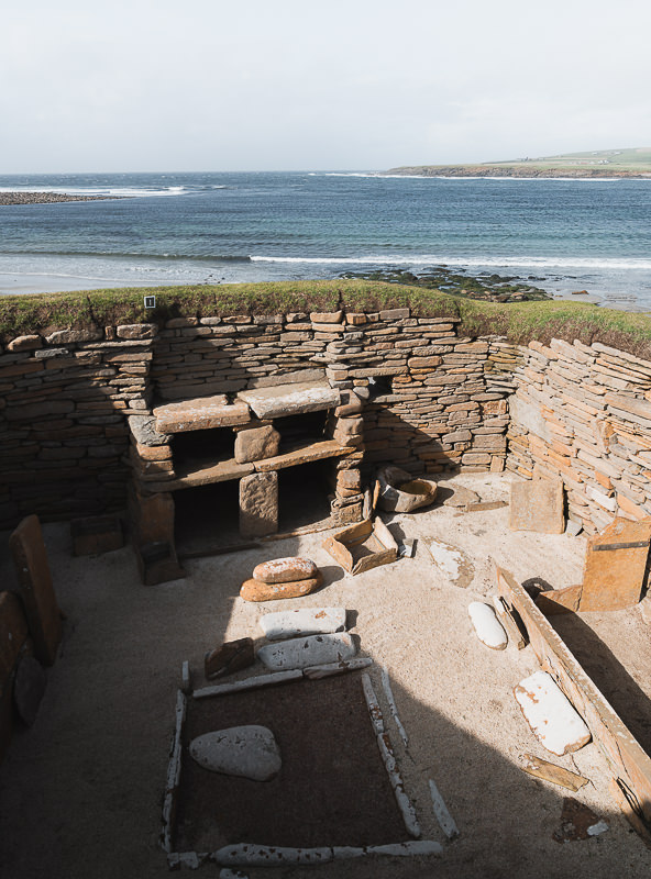 A view down into one of the 5000 year old homes at Skara Brae in the Orkney Islands of Scotland