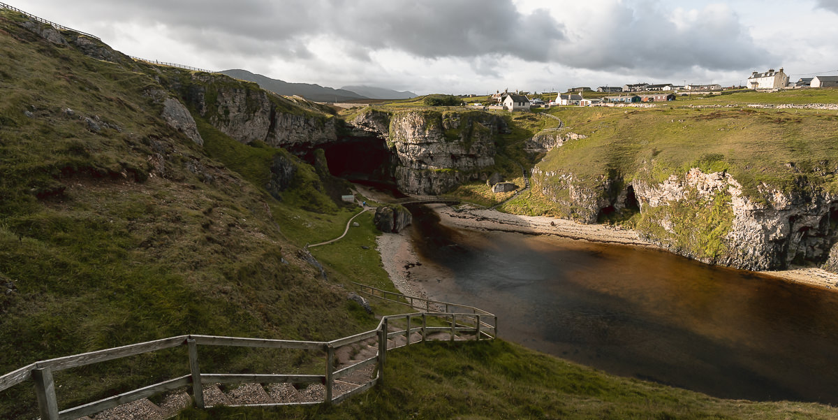 Smoo cave lies beneath the North Coast 500 route and the town of Durness, facing out towards the North Sea.