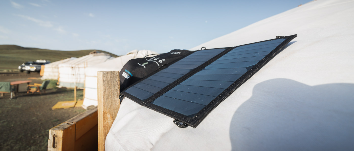 The Anker Solar Panel, seen here on the roof of a Mongolian ger, is always part of our backpacking camping gear setup