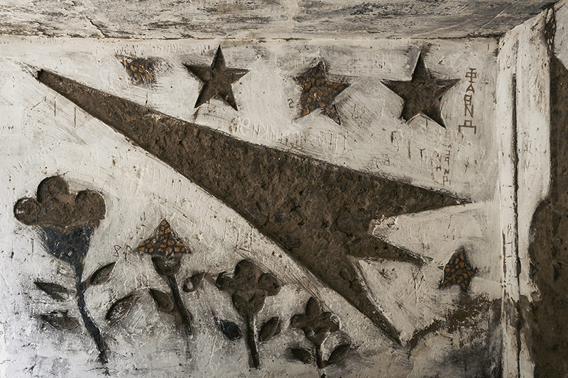 Soviet bus stop designs in poor condition. The rockets and flowers are now devoid of most of their decoration.