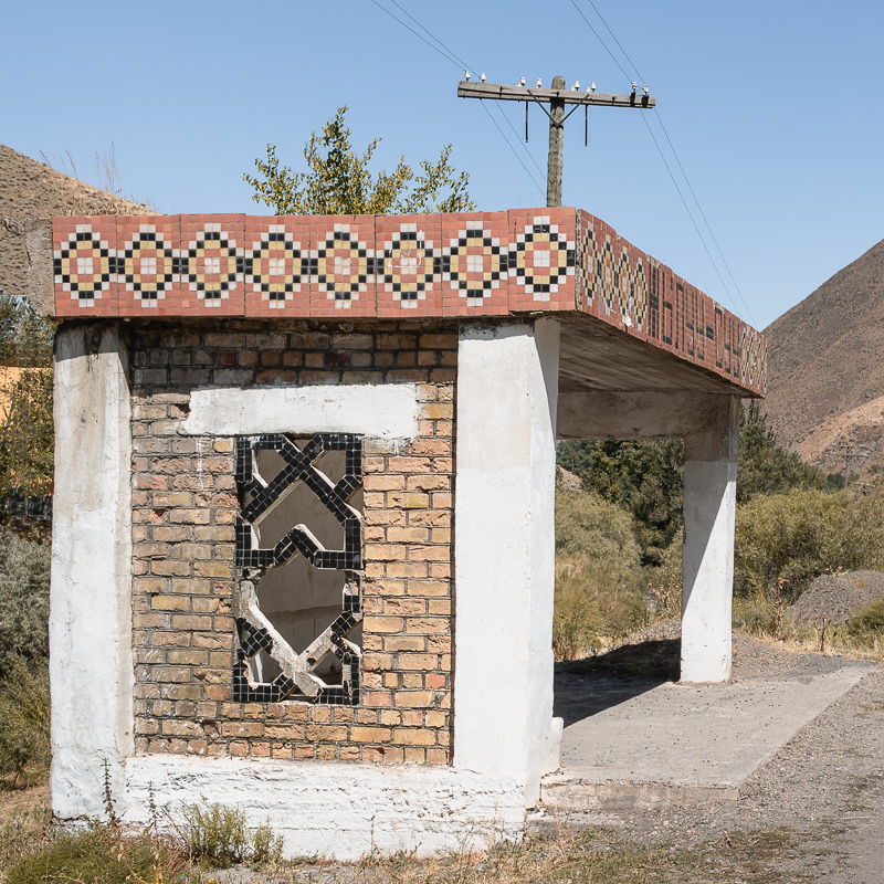 A more simplistic design of Soviet bus stop in the southwest of Kyrgyzstan, with a focus on geometric patterns cut out of the brickwork or inlaid with small tiles